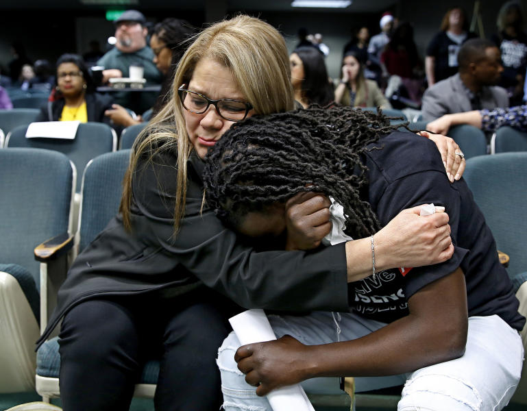 FILE - In this April 9, 2019, file photo, Elizabeth Medrano Escobedo, left, mother of Christian Escobedo, who was killed by Los Angeles police, comforts Ciara Hamilton, whose cousin Diante Yarber was killed by Barstow police, during an Assembly hearing on legislation to restrict the use of deadly force by police in Sacramento, Calif. Both women both spoke in support of a bill, AB392, that would require officers to use de-escalation tactics and allow them to use deadly force only when it is necessary to prevent immediate harm to themselves or others. The bill, AB392, once was vehemently opposed by police. But it is now supported by key law enforcement groups after it was amended last week. (AP Photo/Rich Pedroncelli, File)
