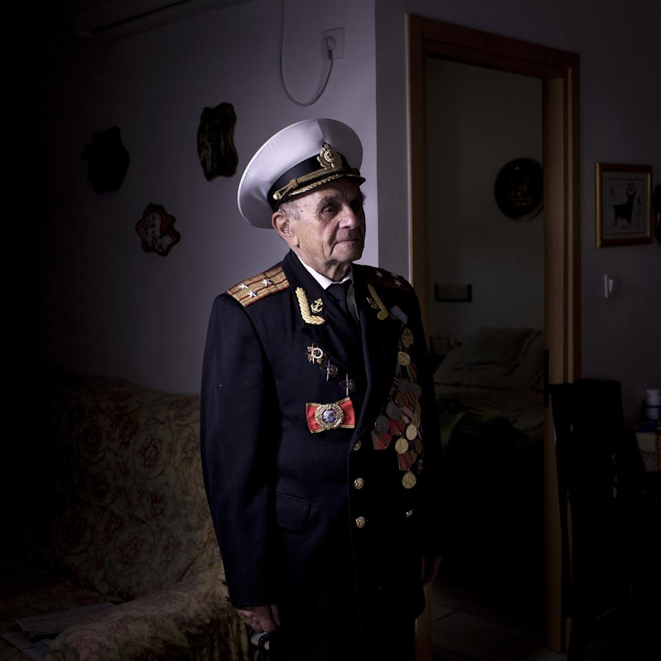 In this photo made Thursday, April 18, 2013, Soviet Jewish World War Two veteran Orlov Naum, 88, poses for a portrait at his house in central Israeli city of Rishon Lezion. Naum joined the Red Army in 1943 after two years of evacuation from Odessa in Kazahstan. He served in 3rd Guard Tank Army at the Voronezh front as an infantry soldier and took part in battle of Kiev and later in battles in Berlin and Prague. During the last days of the war, he was in Prague. After the war, he continued military service in the Navy, served in cruisers Nahimov and Kuibyshev. He immigrated to Israel from Kishinev in 1990. About 500,000 Soviet Jews served in the Red Army during World War Two, and the majority of those still alive today live in Israel. (AP Photo/Oded Balilty)