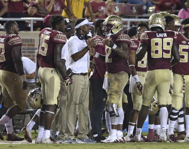 Florida State coach Willie Taggart, center, talks with quarterback Deondre Francois during the fourth quarter against Samford on Saturday in Tallahassee, Florida. Florida State won 36-26. (AP Photo/Steve Cannon)