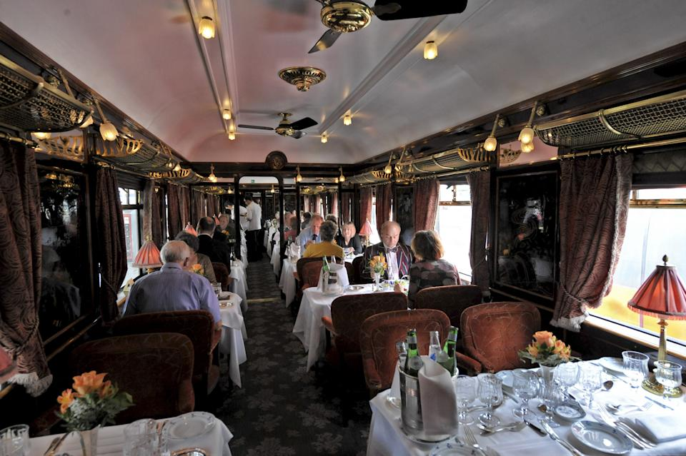 PARIS, FRANCE - OCTOBER 16 : Orient Express Train morning after its departure from Gare Du Nord Station in Paris to Venice in Italy. The art deco dining room with chinese style laque plated wood pannels.October 16, 2008. (Photo by Ariel FUCHS/Gamma-Rapho via Getty Images)