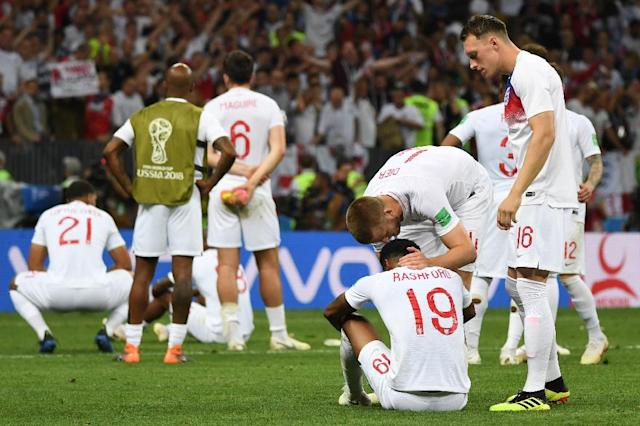 England's bitter disappointed players after their extra-time defeat to Croatia (AFP Photo/MANAN VATSYAYANA)