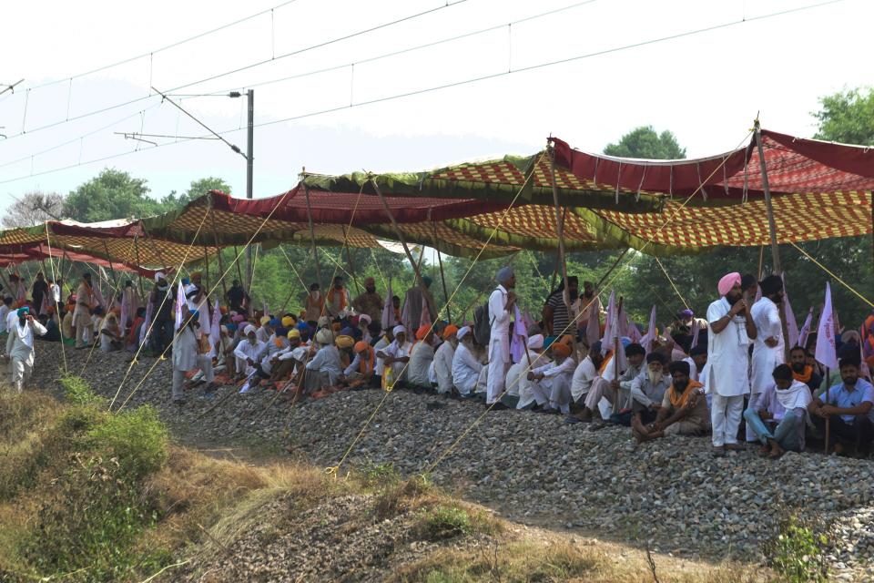 Farmers block train tracks during a protest following the recent passing of agriculture bills in the Lok Sabha (lower house), at Devi Dasspura village some 25 kms from Amritsar on September 24, 2020. (Photo by NARINDER NANU/AFP via Getty Images)
