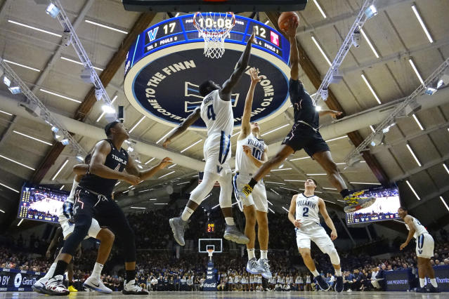 Temple's Nate Pierre-Louis (15) goes up for a shot against Villanova's Cole Swider (10) and Eric Paschall (4) during the first half of an NCAA college basketball game, Wednesday, Dec. 5, 2018, in Villanova, Pa. (AP Photo/Matt Slocum)
