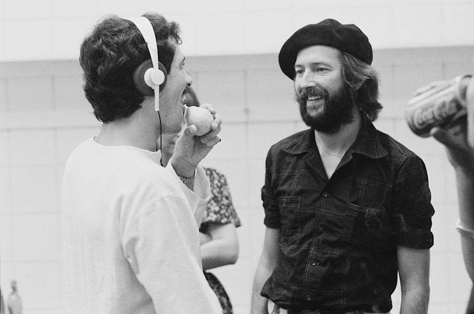 <p>Eric Clapton speaks with his support staff while on tour in the United States in 1975. </p>