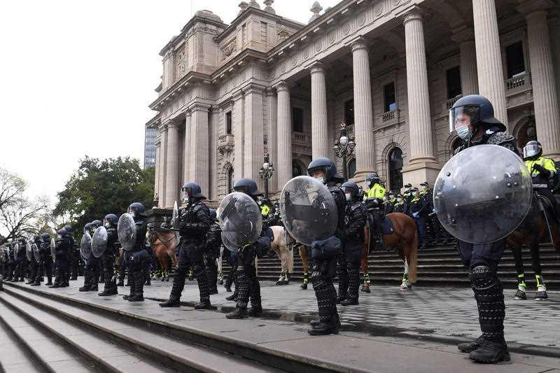Riot police are seen outside the Victoria's Parliament House during a protest by Construction, Forestry, Maritime, Mining and Energy Union (CFMEU) members in Melbourne.