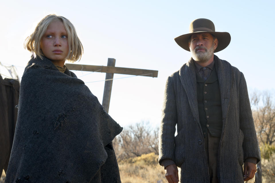 """This image released by Universal Pictures shows Helena Zengel, left, and Tom Hanks in a scene from """"News of the World."""" Zengel was nominated for a Golden Globe for best supporting actress in a motion picture on Wednesday, Feb. 3, 2021 for her role in the film. (Bruce W. Talamon/Universal Pictures via AP)"""