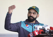 FILE - In this Jan. 17, 2020 file photo, Pakistani cricketer Mohammad Hafeez talks to reporters in Lahore, Pakistan. Pakistan left out Hafeez, its veteran Twenty20 batsman, for the series against South Africa because of a disagreement on meeting the deadline of Pakistan Cricket Board's bio-secure bubble chief selector Mohammad Wasim said on Sunday, Jan. 31, 2021. (AP Photo/K.M. Chaudary, File)