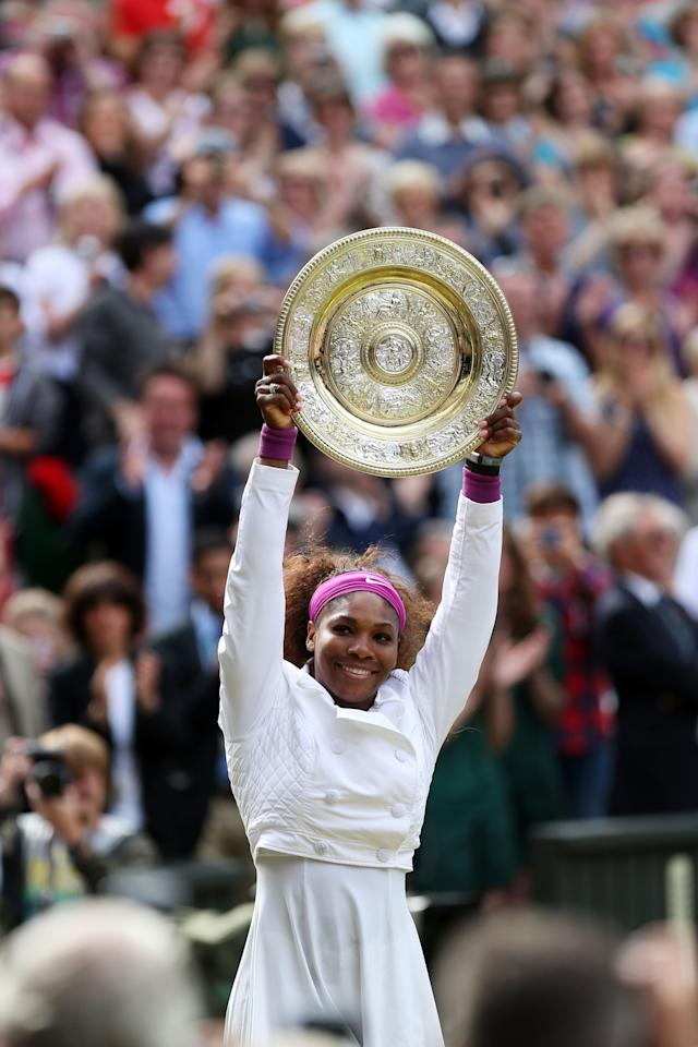 LONDON, ENGLAND - JULY 07:  Serena Williams of the USA lifts the winners trophy and celebrates after her Ladies' Singles final match against Agnieszka Radwanska of Poland on day twelve of the Wimbledon Lawn Tennis Championships at the All England Lawn Tennis and Croquet Club on July 7, 2012 in London, England.  (Photo by Clive Rose/Getty Images)