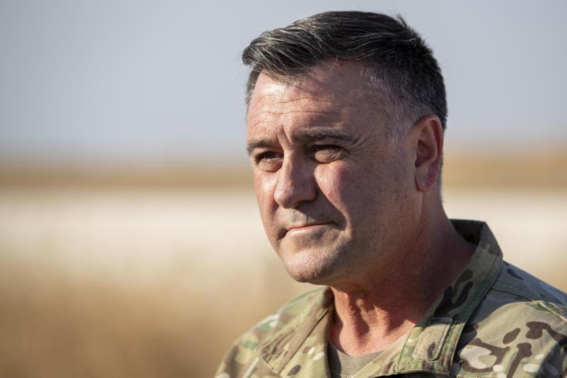 """Air Force Maj. Gen. Eric T. Hill addresses the media at a U.S. military base at undisclosed location in Northeastern Syria, Monday, Nov. 11, 2019.   Hill told The Associated Press on Friday, Nov. 15,  that Islamic State militants remain """"a global threat"""" and that the partnership with the Kurds and international action is still needed against it.  (AP Photo/Darko Bandic)"""