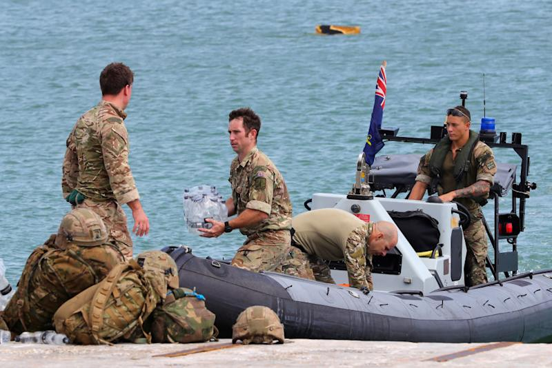 Members of the Humanitarian and Disaster Relief (HADR) team from The Royal Fleet Auxiliary ship Mounts Bay deliver aid to the Islanders of Great Abaco in The Bahamas on September 4, 2019. | AFP Photo / UK MOD / CROWN COPYRIGHT 2019
