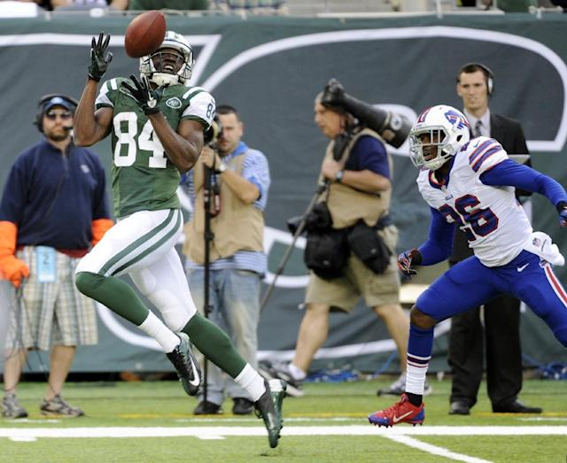 New York Jets wide receiver Stephen Hill (84) catches a pass in front of Buffalo Bills defensive back Justin Rogers (26) for a touchdown during the first half of an NFL football game Sunday, Sept. 22, 2013, in East Rutherford, N.J. (AP Photo/Bill Kostroun)