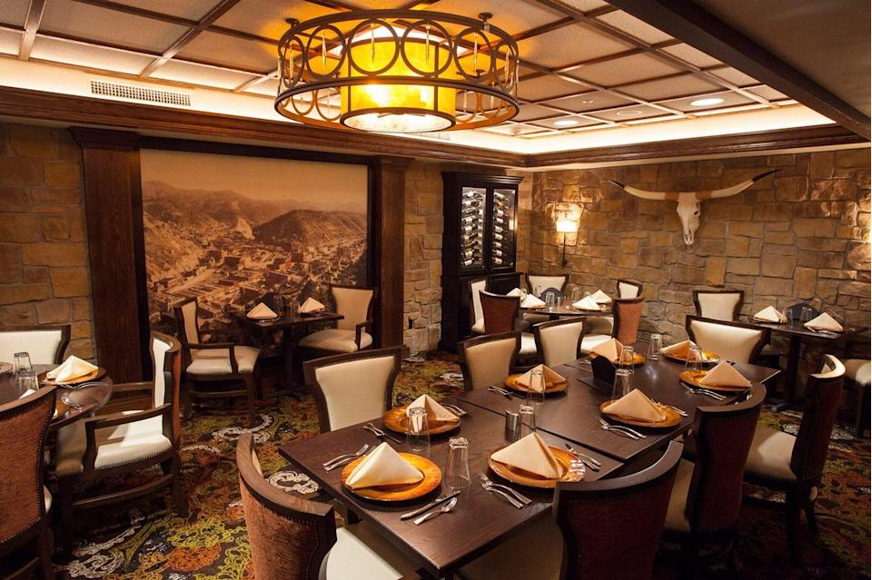 """<p>The peak of the Gold Rush brought a flood of visitors to Deadwood, and <a href=""""https://www.tripadvisor.com/Restaurant_Review-g54578-d7262927-Reviews-Deadwood_Legends_Steakhouse_at_The_Franklin_Hotel-Deadwood_South_Dakota.html"""" rel=""""nofollow noopener"""" target=""""_blank"""" data-ylk=""""slk:this eatery"""" class=""""link rapid-noclick-resp"""">this eatery</a>, originally part of the Silverado Franklin Hotel, became a local hotspot. It was built in 1902 on the site of one of the first gold discoveries, and greats such as John Wayne, Buffalo Bill, and Teddy Roosevelt stopped in through the years for prime rib.</p>"""
