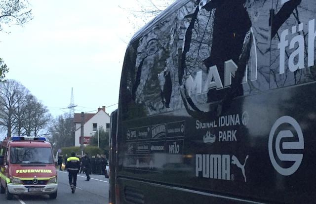 <p>A window of the bus of Borussia Dortmund is damaged after an explosion before the Champions League quarterfinal soccer match against AS Monaco in Dortmund, western Germany, Tuesday, April 11, 2017. (Carsten Linhoff/dpa via AP) </p>