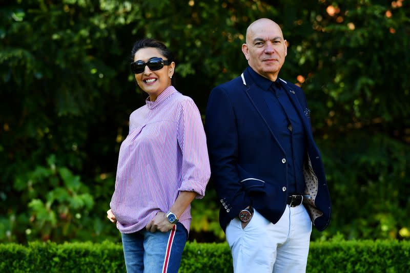 Lucio Santoro and Meera, his partner and co-founder of The Santoro Group pose for a portrait in Oxshott