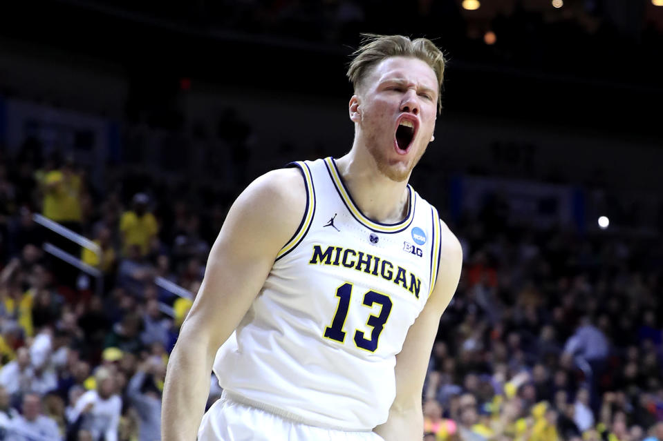 <p>Ignas Brazdeikis #13 of the Michigan Wolverines reacts after a dunk against the Florida Gators during the first half in the second round game of the 2019 NCAA Men's Basketball Tournament at Wells Fargo Arena on March 23, 2019 in Des Moines, Iowa. (Photo by Andy Lyons/Getty Images) </p>