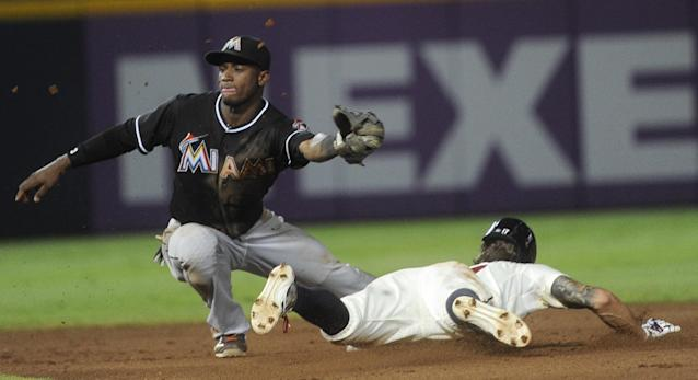 Atlanta Braves' Jordan Schafer steals second base for the second time in the game as Miami Marlins shortstop Adeiny Hechavarria reaches for the throw during the fifth inning of a baseball game, Saturday, Aug. 31, 2013, in Atlanta. (AP Photo/John Amis)