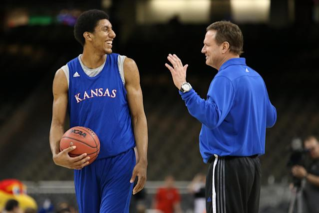 NEW ORLEANS, LA - MARCH 30: Kevin Young #40 talks with head coach Bill Self of the Kansas Jayhawks during practice prior to the 2012 Final Four of the NCAA Division I Men's Basketball Tournament at the Mercedes-Benz Superdome on March 30, 2012 in New Orleans, Louisiana. (Photo by Ronald Martinez/Getty Images)