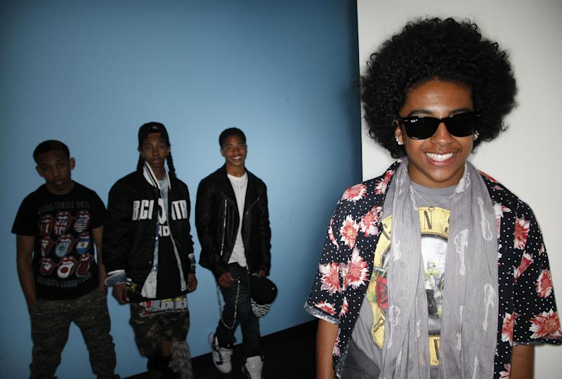"""CAPTION CORRECTION OF NAME: In this Tuesday, April 9, 2013 photo, members of teen R&B boy band, Mindless Behavior, Princeton, from right, Roc Royal, Ray Ray, and Prodigy pose for photos in Los Angeles. The group kicks off their """"All Around the World"""" tour July 3, 2013, in Stockton, Calif. (AP Photo/Jae C. Hong)"""