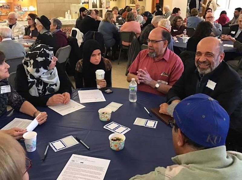 """Muslim and Jewish community members speak at a """"Meet a Muslim"""" event at a synagoguein March."""