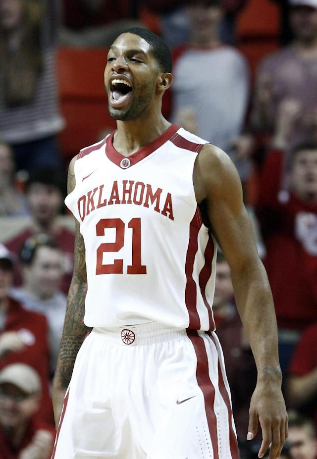 Oklahoma guard Cameron Clark celebrates after dunking against Iowa State during the first half of an NCAA college basketball game in Norman, Okla. on Saturday, Jan. 11, 2014. (AP Photo/Alonzo Adams)