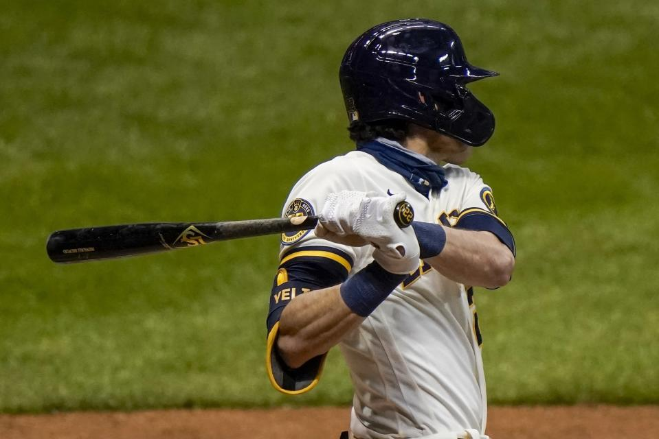 Milwaukee Brewers' Christian Yelich hits a single during the third inning of a baseball game against the St. Louis Cardinals Tuesday, Sept. 15, 2020, in Milwaukee. (AP Photo/Morry Gash)