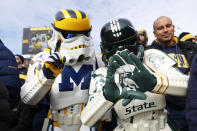 A Michigan and Michigan State fan dressed in Star Wars stormtrooper outfits watch in the second half of an NCAA college football game in Ann Arbor, Mich., Saturday, Nov. 16, 2019. (AP Photo/Paul Sancya)