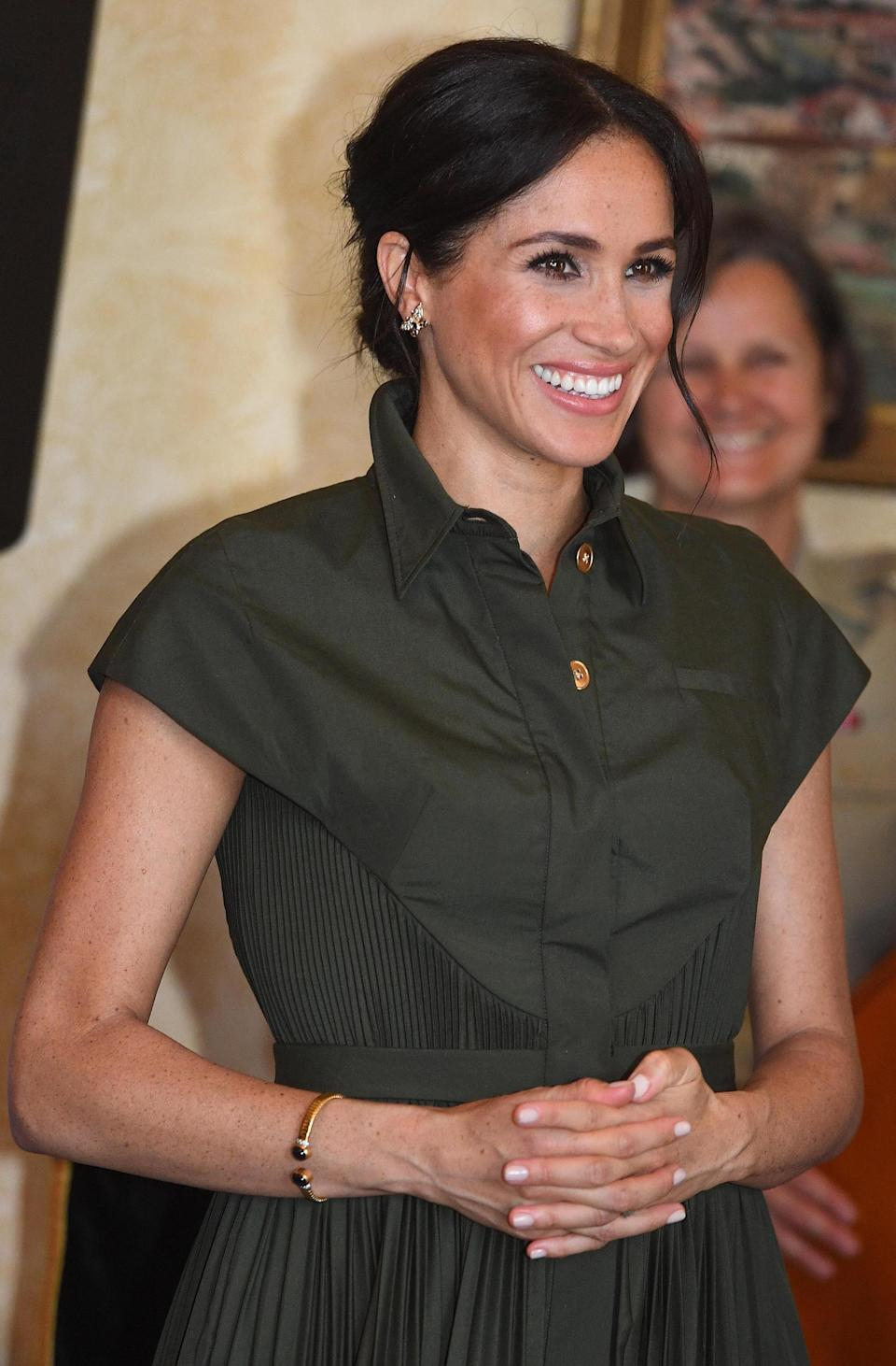 <p>The mum-to-be definitely had that pregnancy glow and was beaming as she watched her husband make a speech at Admiralty House. She also changed her hair for the afternoon and opted for a classic up-do hairstyle Source: Getty </p>