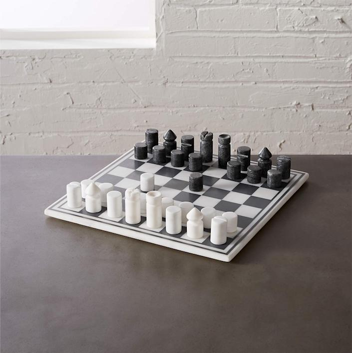 """For the dad who binged <em>The Queen's Gambit</em>, a modern chess set to play and display. $100, CB2. <a href=""""https://www.cb2.com/marble-chess-game/s464222"""" rel=""""nofollow noopener"""" target=""""_blank"""" data-ylk=""""slk:Get it now!"""" class=""""link rapid-noclick-resp"""">Get it now!</a>"""