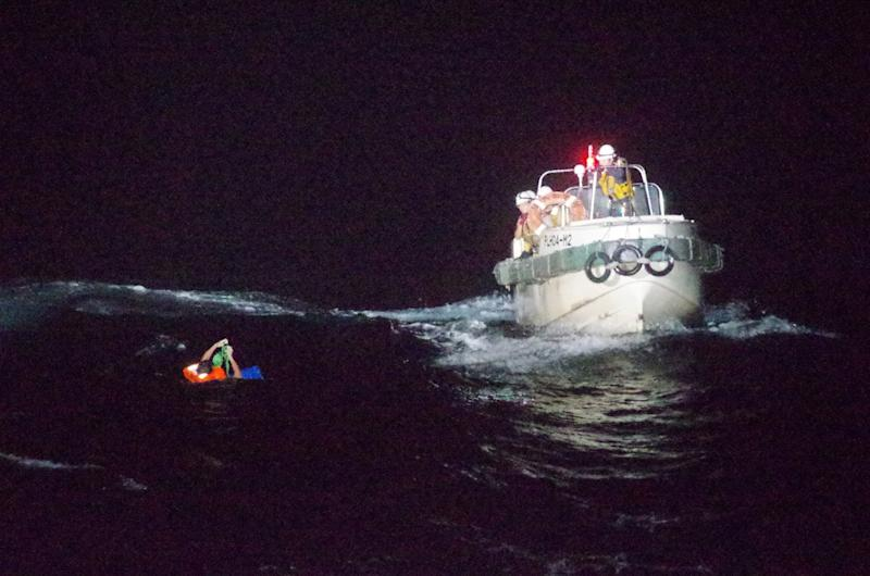 A Filipino crew member believed to be onboard Gulf Livestock 1, a cargo ship carrying livestock and dozens of crew members that went missing after issuing a distress signal due to Typhoon Maysak, is rescued by a Japan Coast Guard boat during their search and rescue operation at the East China Sea, to the west of Amami Oshima island in southwestern Japan.
