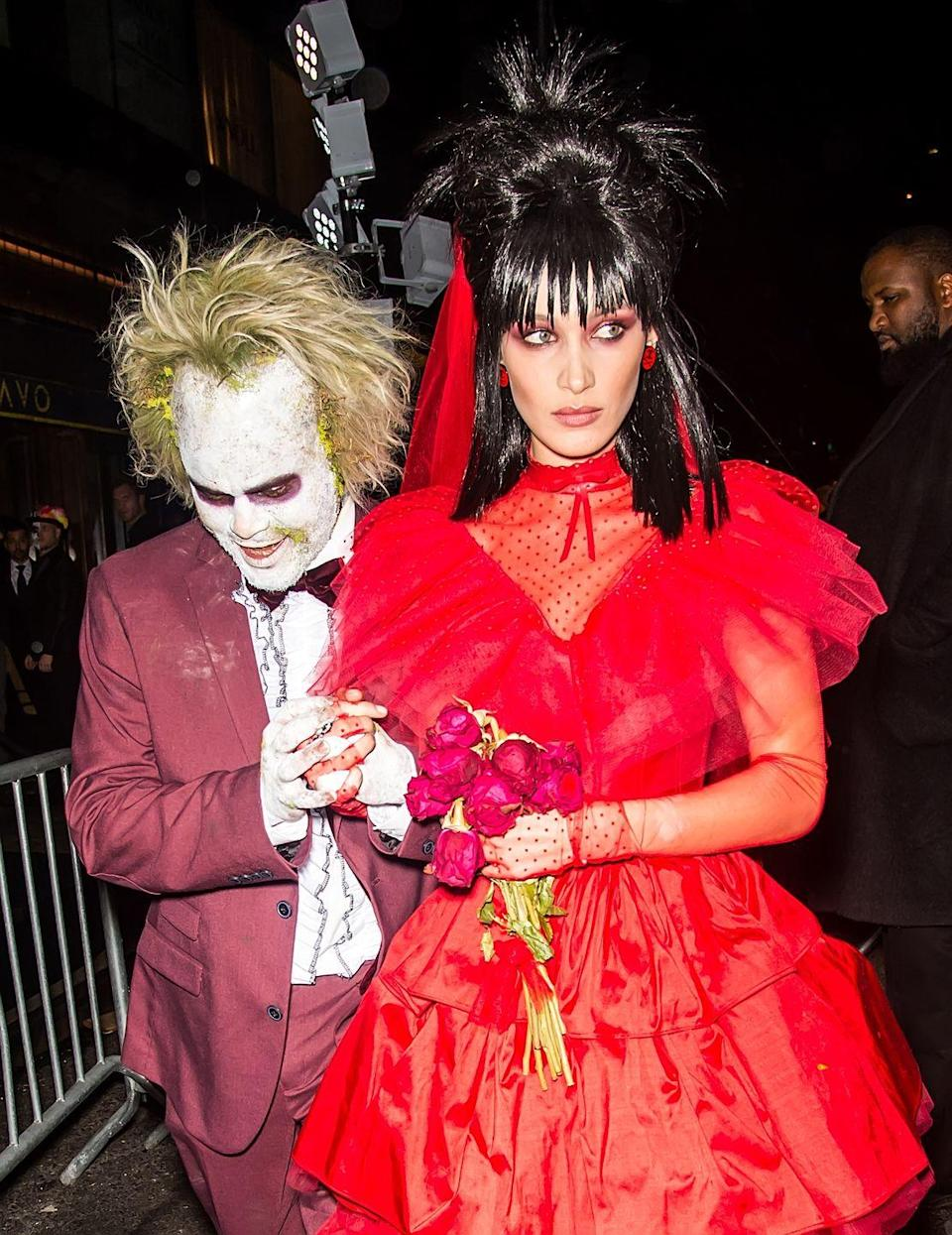 <p>Bella Hadid impersonated Lydia Deetz from Tim Burton's 1988 <em>Beetlejuice</em> film with a frothy bloodred tulle gown, layered over a polka-dot sheer blouse. Ace this look by teasing your hair and adding a bouquet of dead red roses. </p>