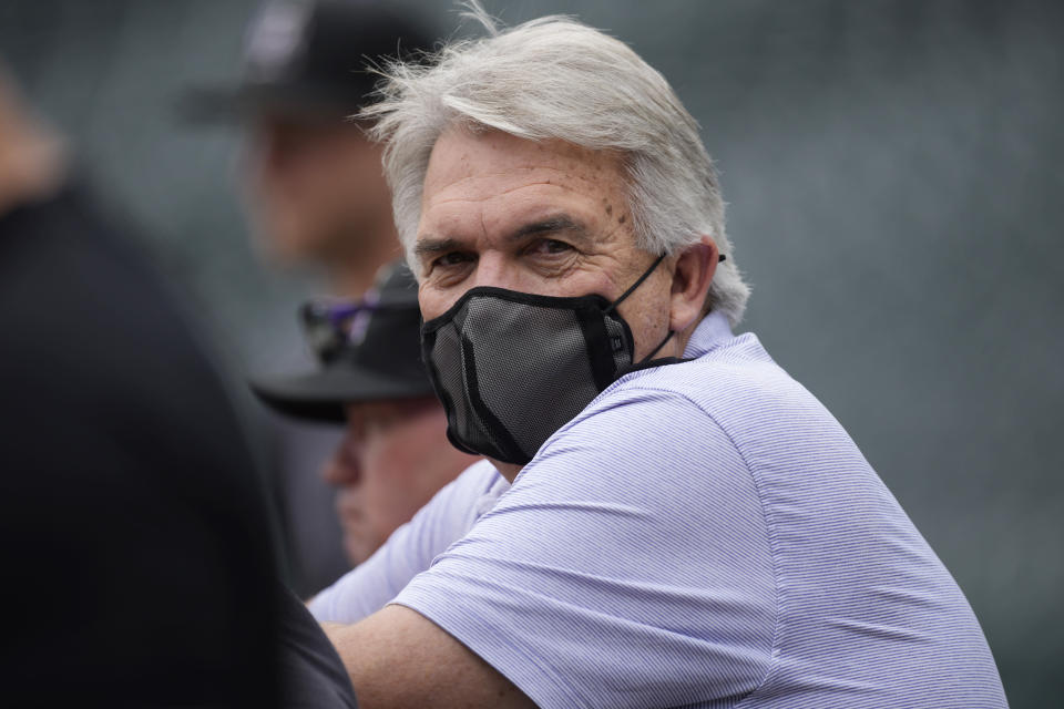 Colorado Rockies interim general manager Bill Schmidt wears a face covering during batting practice before the team's baseball game against the Los Angeles Dodgers on Friday, July 16, 2021, in Denver. Four Rockies players and manager Bud Black have been put on COVID-19 protocol before the game. (AP Photo/David Zalubowski)