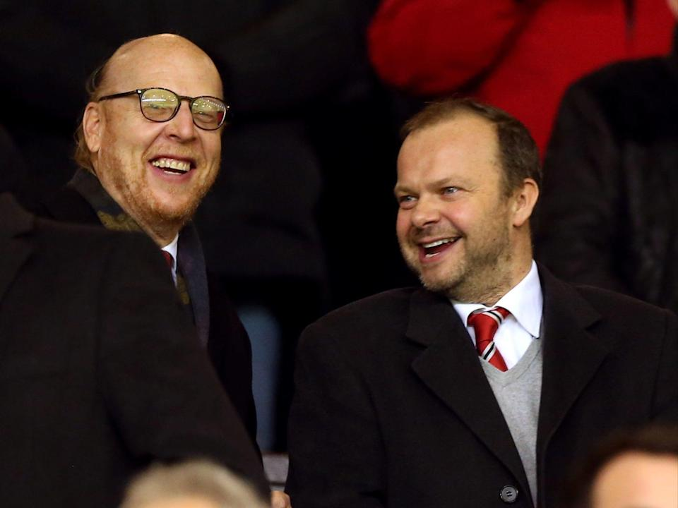 Manchester United owner Avram Glazer (left) and executive vice chairman Ed Woodward (PA)