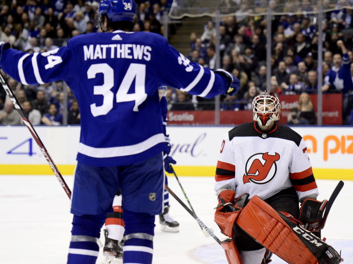 New Jersey Devils goaltender Louis Domingue (70) reacts after giving up a goal to Toronto Maple Leafs center Auston Matthews (34) during the second period of an NHL hockey game Tuesday, Jan. 14, 2020, in Toronto. (Frank Gunn/The Canadian Press via AP)
