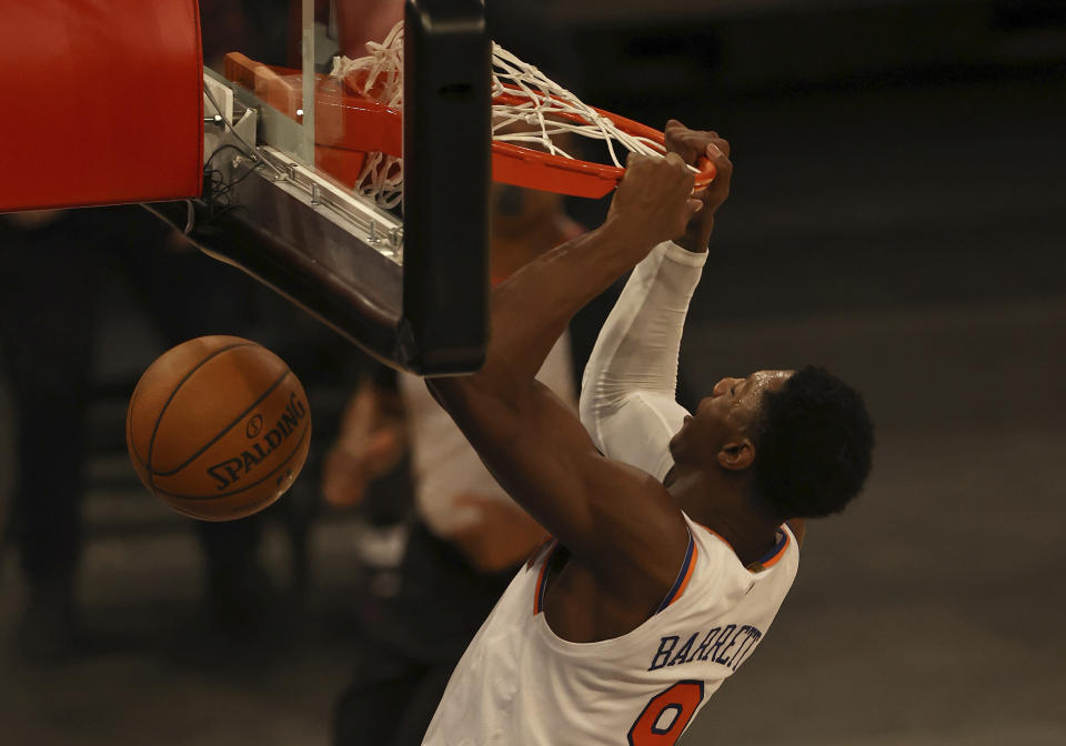 New York Knicks' RJ Barrett dunks in the second half against the Indiana Pacers during an NBA basketball game Saturday, Feb. 27, 2021, in New York. (Elsa/Pool Photo via AP)