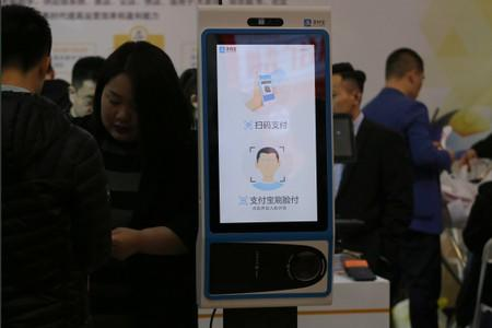 A machine with Alipay's facial recognition payment system is displayed at a smart business fair in Nanjing, Jiangsu