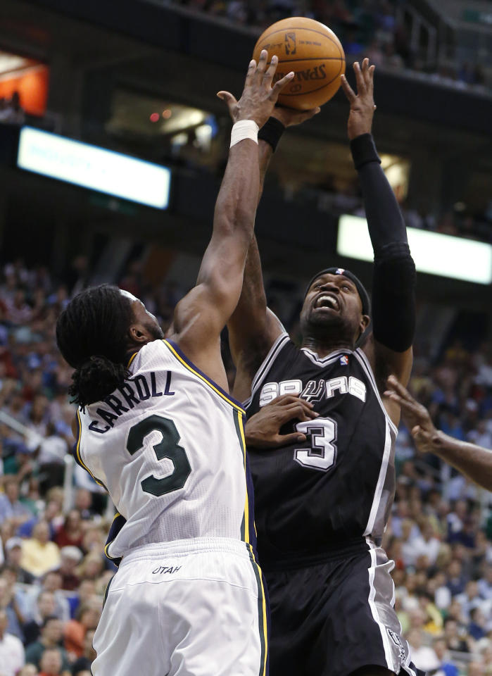 San Antonio Spurs guard Stephen Jackson (3) takes a shot over Utah Jazz forward DeMarre Carroll (3) during the first half of an NBA basketball game Monday, April 9, 2012, in Salt Lake City. (AP Photo/Jim Urquhart)