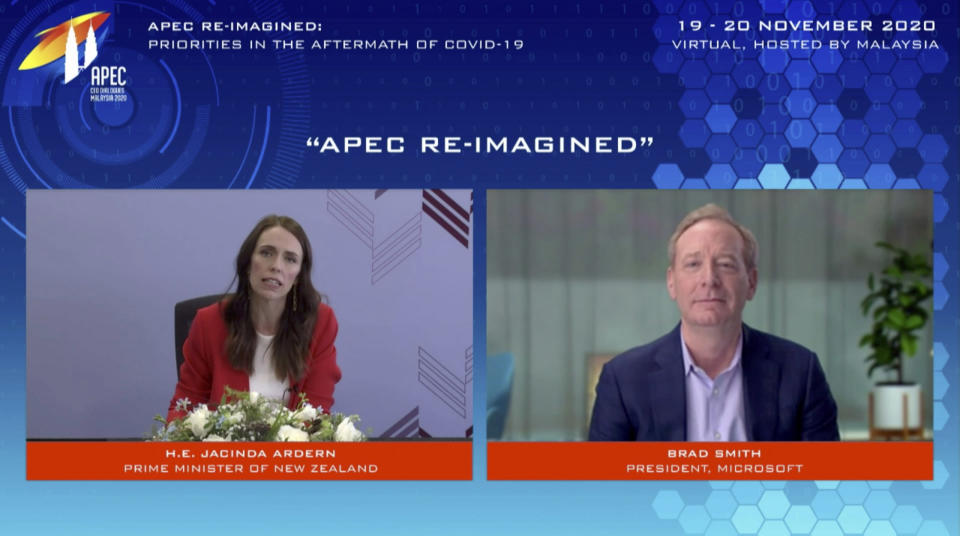 In this image from video released by APEC CEO Dialogues Malaysia 2020, New Zealand's Prime Minister Jacinda Ardern, left, speaks as Microsoft President Brad Smith listens at a CEO Dialogue forum via video link, ahead of the Asia-Pacific Economic Cooperation (APEC) leaders' summit, hosted by Malaysia, in Kuala Lumpur, Malaysia, Friday, Nov. 20, 2020. (APEC CEO Dialogues Malaysia 2020 via AP)