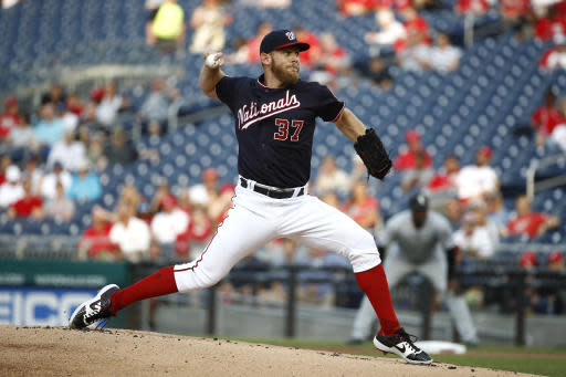 FILE - In this June 4, 2019, file photo, Washington Nationals starting pitcher Stephen Strasburg throws to the Chicago White Sox in the first inning of an interleague baseball game in Washington. Major League Baseball season shrunk down to just 60 games in the pandemic-shortened 2020 season. Last year, the Nationals played their 60th of 162 games on June 4 -- and came back to beat the visiting Chicago White Sox 9-5. (AP Photo/Patrick Semansky, File)