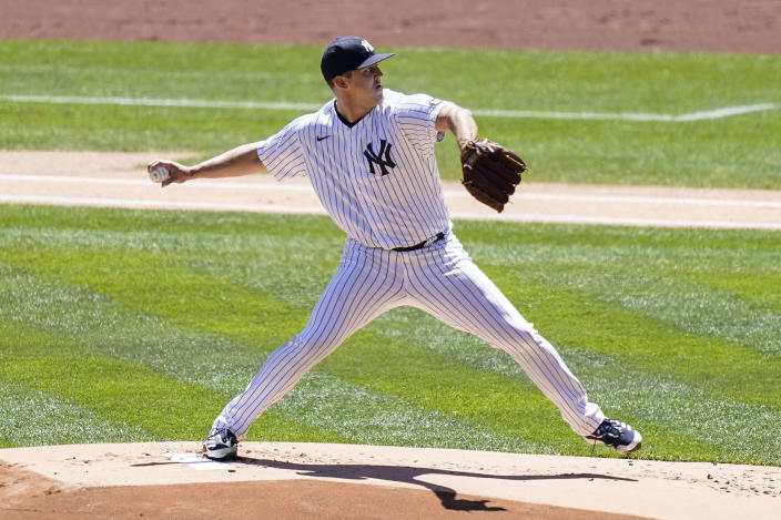 New York Yankees starting pitcher Jameson Taillon (50) throws in the first inning of a baseball game against the Detroit Tigers, Saturday, May 1, 2021, in New York. (AP Photo/John Minchillo)
