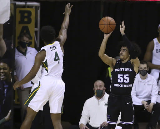 Central Arkansas guard DeAndre Jones (55) shoots a three point shot against Baylor guard L.J. Cryer (4) in the first half of an NCAA college basketball game, Tuesday, Dec. 29, 2020, in Waco, Texas. (AP Photo/ Jerry Larson)