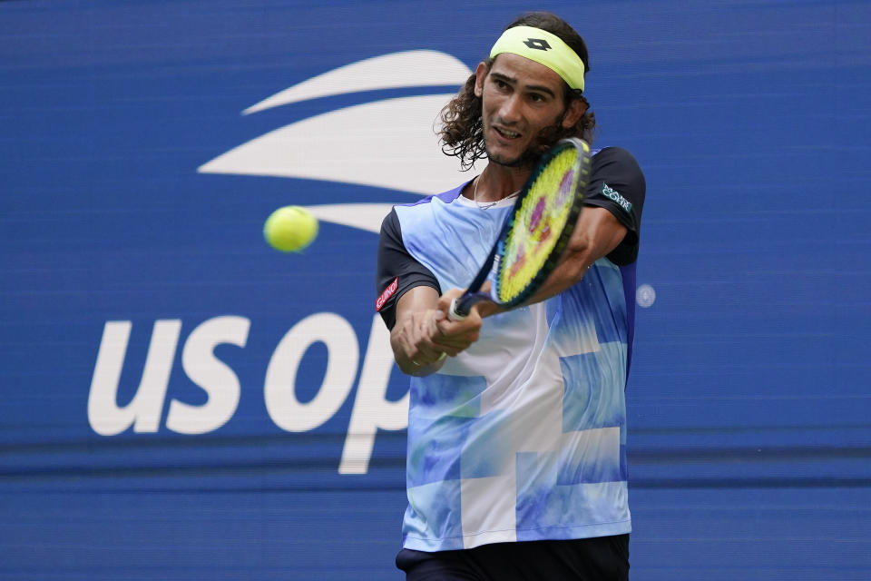 Lloyd Harris, of South Africa, returns a shot to Alexander Zverev, of Germany, during the quarterfinals of the US Open tennis championships, Wednesday, Sept. 8, 2021, in New York. (AP Photo/Elise Amendola)