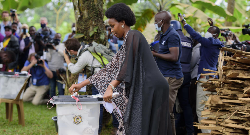 Uganda's leading opposition challenger Bobi Wine's wife, Barbie Kyagulanyi, casts her vote in Kampala, Uganda, Thursday, Jan. 14, 2021. Ugandans are voting in a presidential election tainted by widespread violence that some fear could escalate as security forces try to stop supporters of Wine from monitoring polling stations.(AP Photo/Nicholas Bamulanzeki)