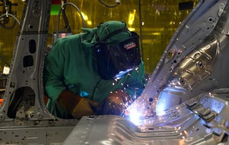 Line workers spot weld parts of the frame on the flex line at Nissan Motor Co's automobile manufacturing plant in Smyrna Tennessee