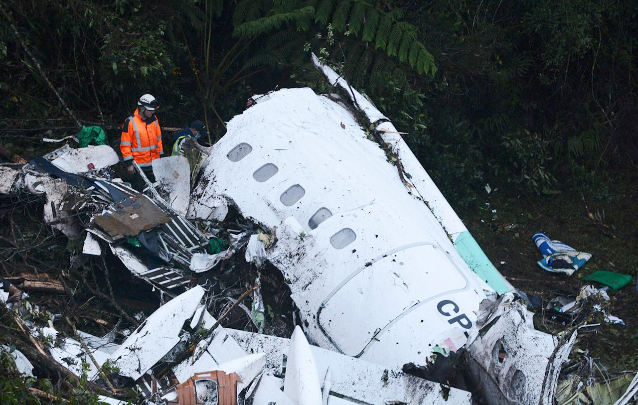 <p>Rescue workers search at the wreckage site of a chartered airplane that crashed outside Medellin, Colombia, Tuesday, Nov. 29, 2016. (AP Photo/Luis Benavides) </p>