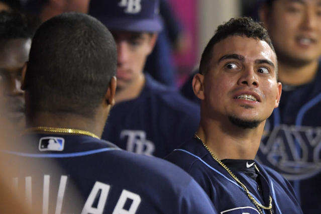 Tampa Bay Rays' Willy Adames, right, jokes with Jesus Aguilar after hitting a solo home run during the third inning of the team's baseball game against the Los Angeles Angels on Friday, Sept. 13, 2019, in Anaheim, Calif. (AP Photo/Mark J. Terrill)