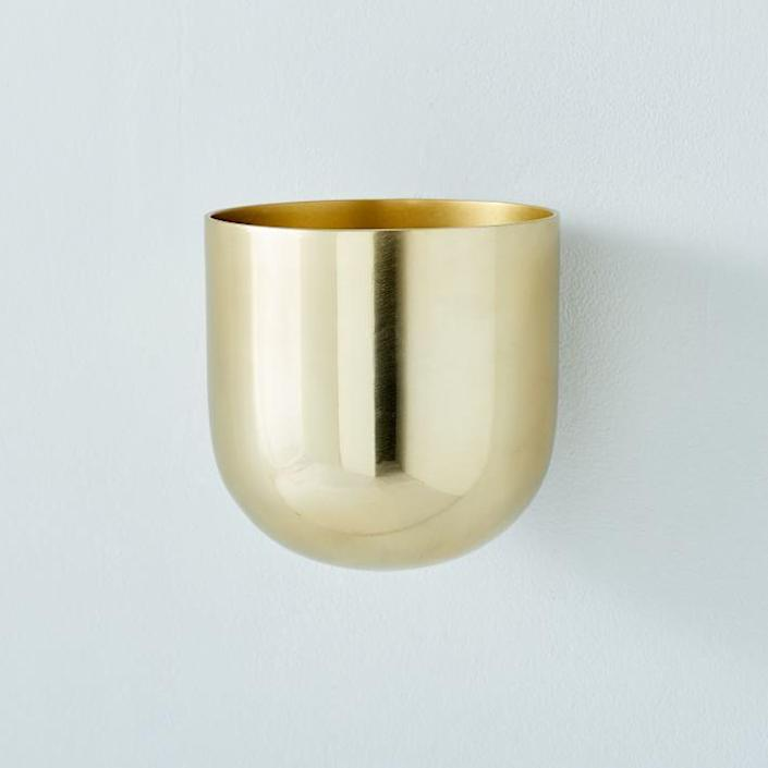 "This metal planter is available in both antique brass and polished nickel and also comes in large and small varieties. $30, West Elm. <a href=""https://www.westelm.com/products/metal-wallscape-planters-d7622/?sku=1194793&cm_ven=PLA&cm_ite=1194793&cm_cat=Google&cm_pla=Local&gclid=EAIaIQobChMI-dyxl8in6gIVdf3jBx02mw_REAQYAiABEgIcmfD_BwE"" rel=""nofollow noopener"" target=""_blank"" data-ylk=""slk:Get it now!"" class=""link rapid-noclick-resp"">Get it now!</a>"