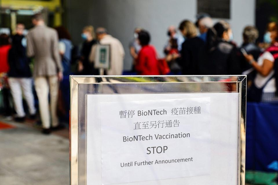 A sign outside a vaccination centre in Hong Kong on Wednesday informs people that the use of BioNTech shots has been suspended. Photo: Reuters