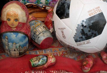 A replica of the FIFA World Cup ball and Matryoshka souvenirs are seen in a shop window in central Moscow, Russia, July 3, 2018. REUTERS/John Sibley