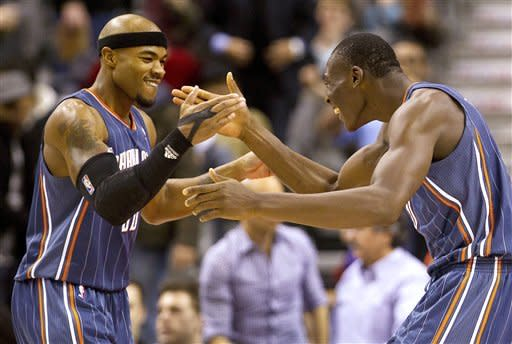 Charlotte Bobcats forwards Bismack Biyombo, right, and Corey Maggette, left, celebrate their 98-91 win over the Toronto Raptors in an NBA basketball game, Friday, Feb. 17, 2012, in Toronto. (AP Photo/The Canadian Press, Frank Gunn)