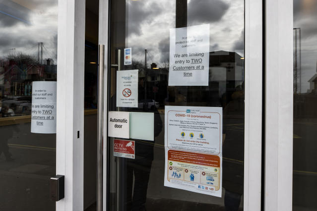 A pharmacy on the Falls Road, Belfast, limits customers to two at any one time. (Getty Images)